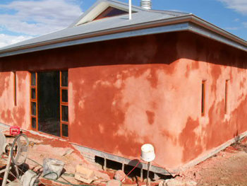 Straw bale wall finishing exterior
